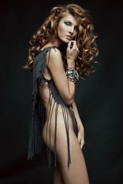 photograph of a model wearing a grey rag dress
