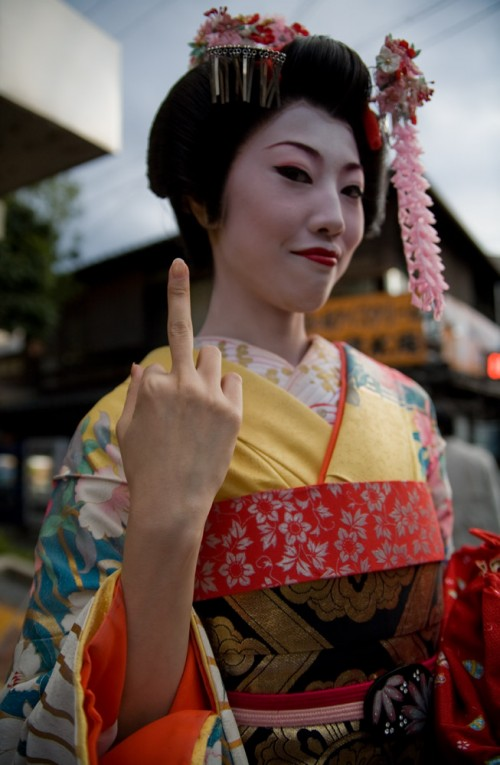 photo of a japanese woman flipping the bird