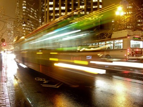 long-exposure photograph of a blurry bus on a street