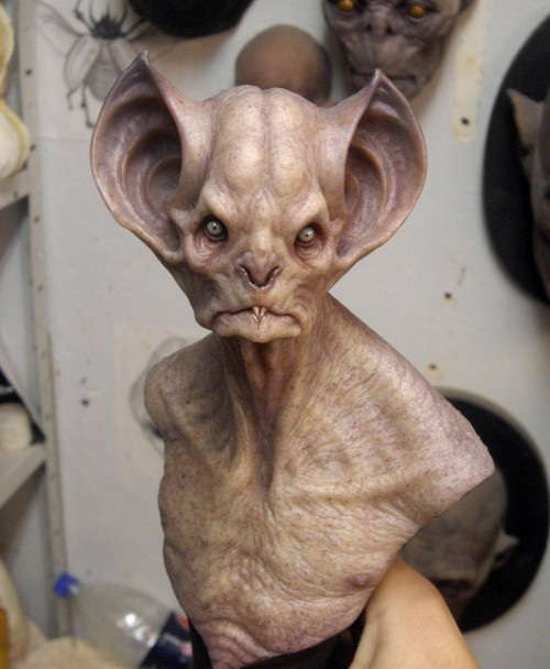 bust sculpture of a bat-like montser with gigantic ears
