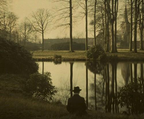 vintage photograph of a man sitting near a pond