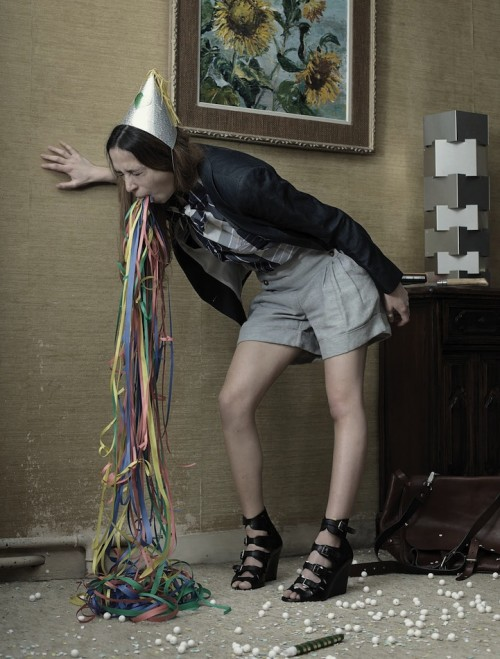 photograph of a woman vomiting confetti