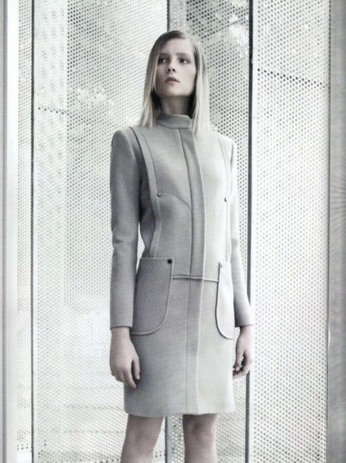 woman in a tailored grey suit