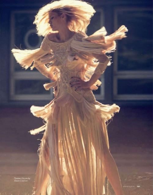 fashion shoot photo of a model turning wearing an elaborate dress