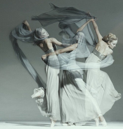 photograph of dancers in flowing grey and white dresses
