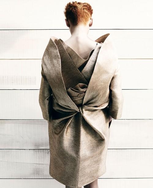 tilda swinton wearing an ornate folded gown photographed by bran adama