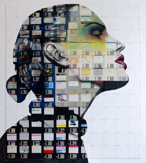 portrait of a woman in profile painted on old floppy disks