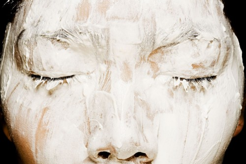 woman with white paste on face