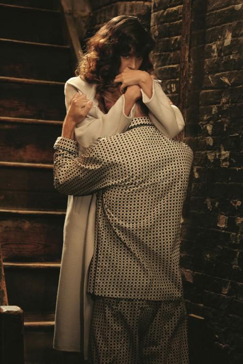 photograph of a woman hugging a man