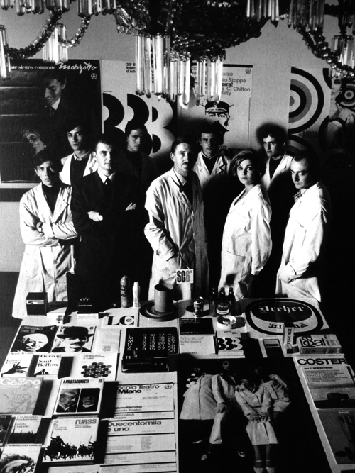 photograph of design studio staff wearing white lab coats