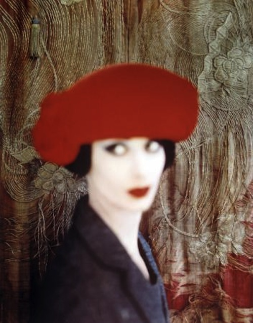 portrait of a model in a red hat, out of focus
