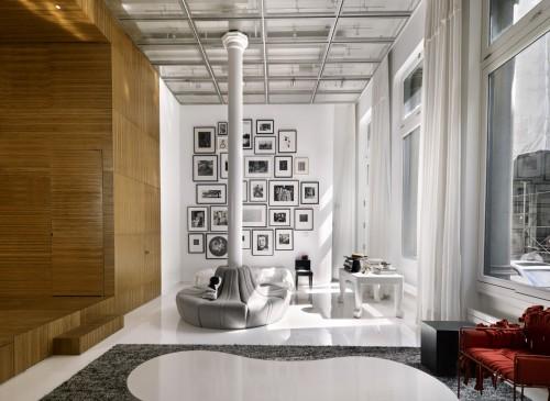 loft with photos on wall