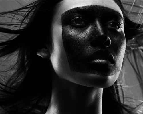 olga kurylenko with face painted black