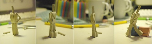 Paper person posing