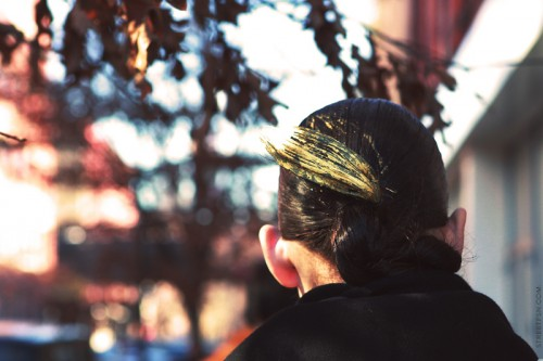 woman with paint smear on the back of her head