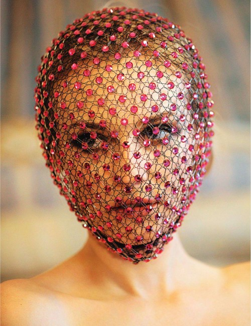 woman with red fishnet veil