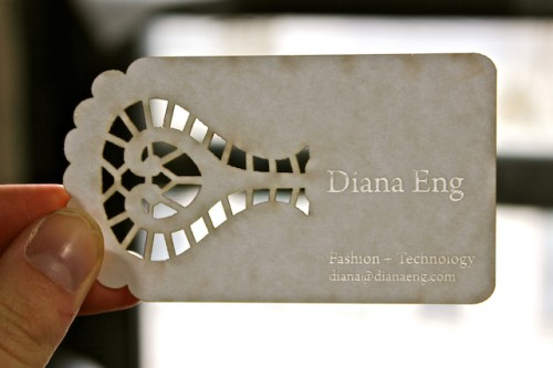 Lasercut business card, mildly burnt at the edges.