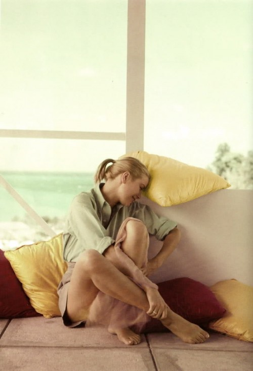 Grace Kelly in shirt and khaki shorts by Howell Conant