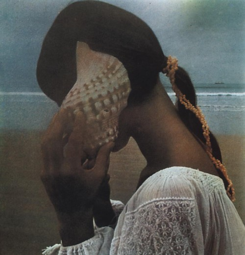 Photo of a girl listening to a sea shell by David Hamilton