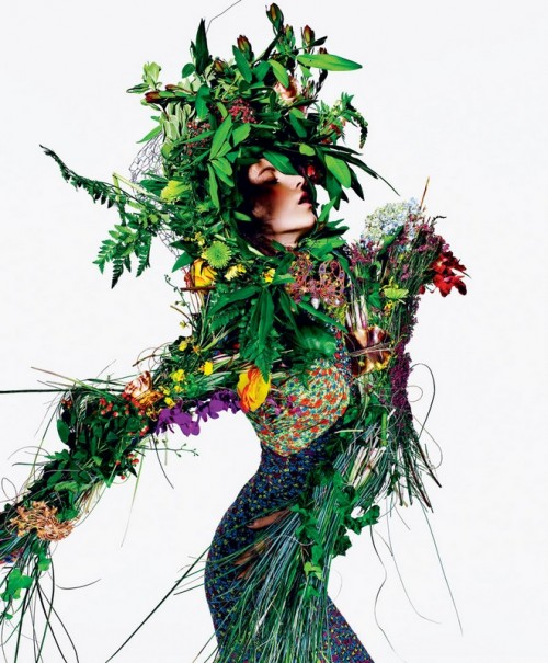 woman dressed in leaves and plants