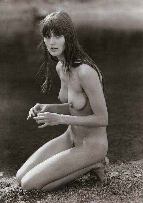 anouck lepere nude crouching near water