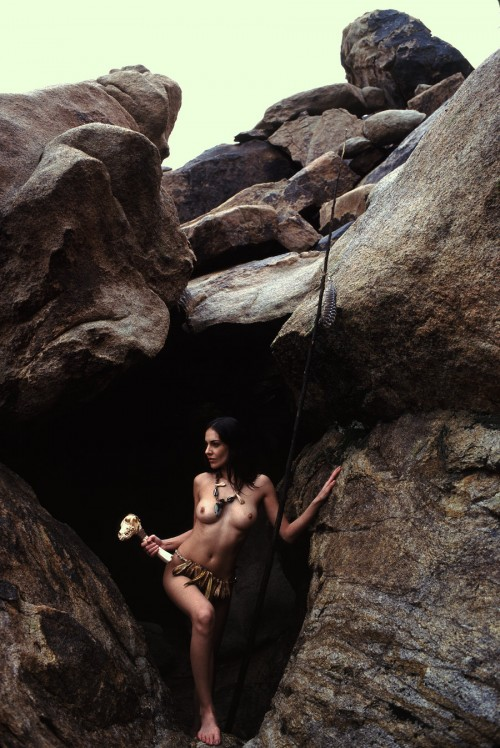 Nude woman emerging from a Shaman's Cave