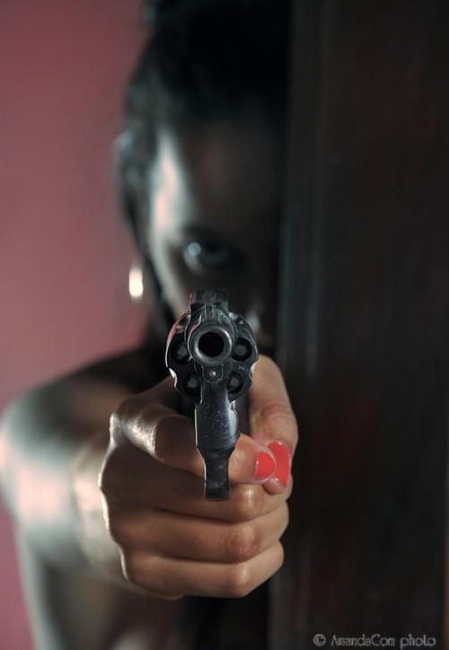 Woman pointing a gun