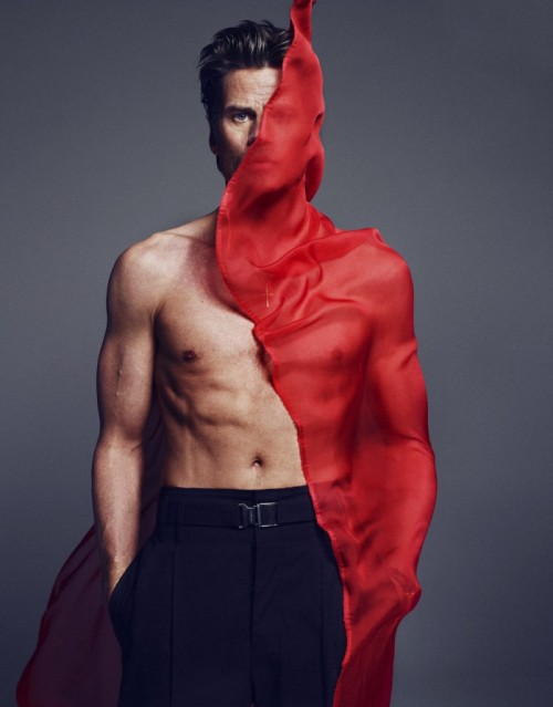 Marc Vanderloo shirtless with a piece of red fabric wind-blown against one side, by Txema Yeste