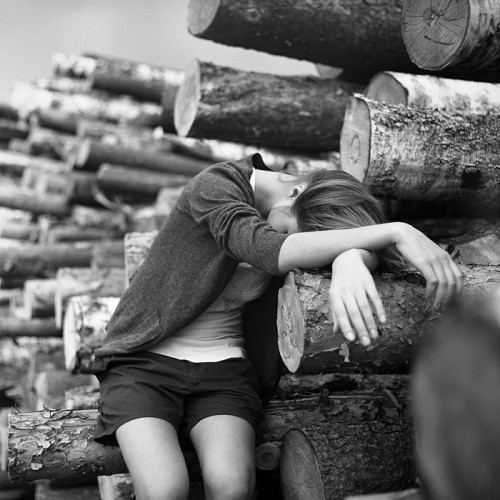 Girl and tree trunks by Aleksey Chizhik