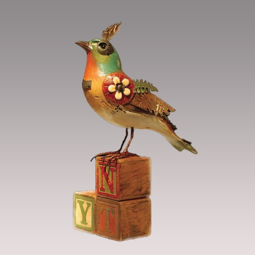 Bird with plume on vintage alphabet blocks
