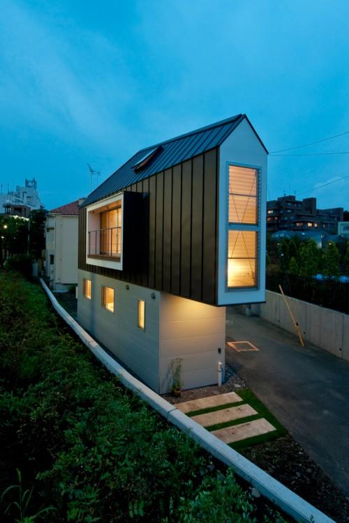 Exterior of narrow house at night