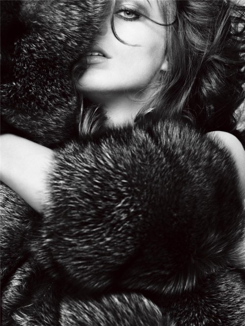 woman wrapped in furs