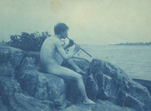 Cyanotype photographh of a nude man playing pipe by Frances Benjamin Johnston